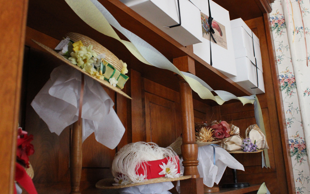 Wall display of hats for sale at Cohen Millinery