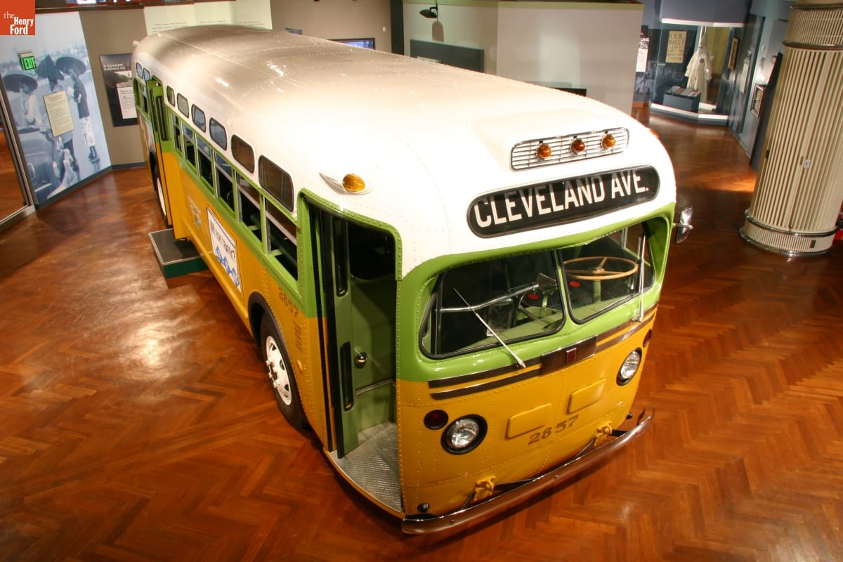 Yellow and lime green bus with white roof