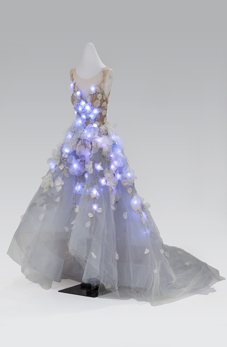 Dress on dress form with glowing blue lights integrated into bodice and skirt