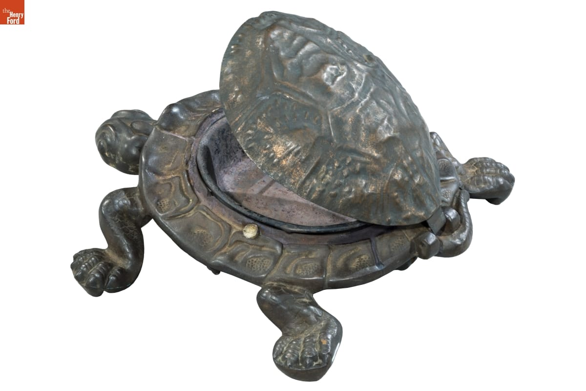 Metal turtle whose shell opens to reveal a bowl inside