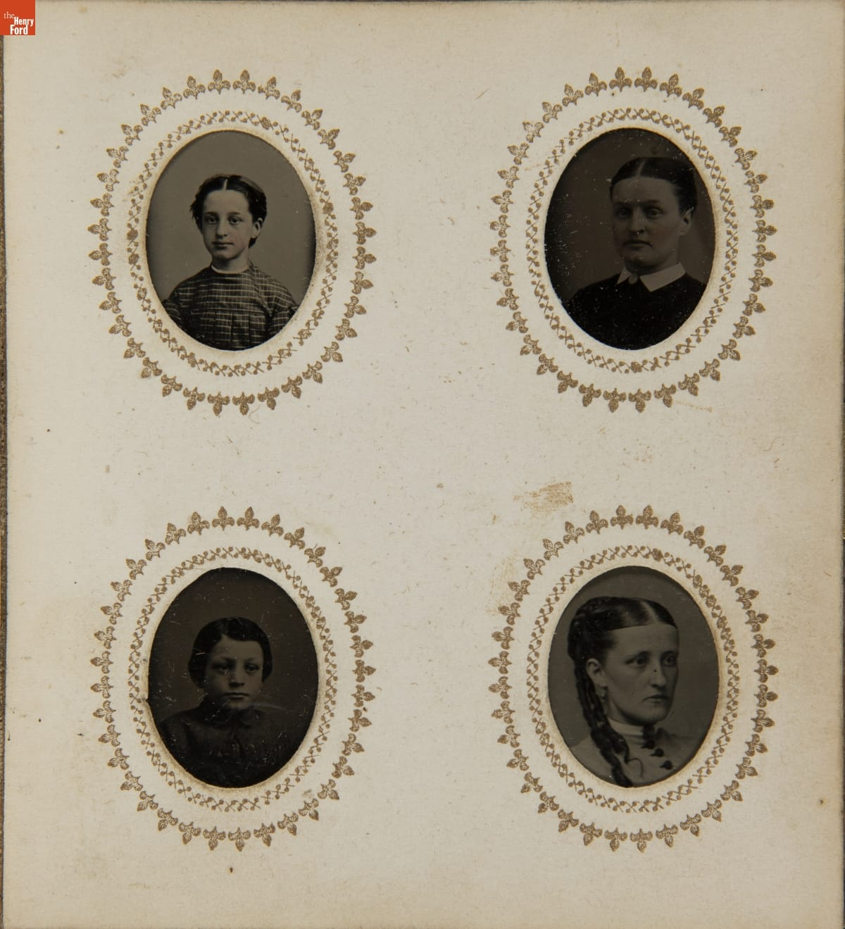 Page containing four oval head-and-shoulder portraits with decorative borders around each portrait