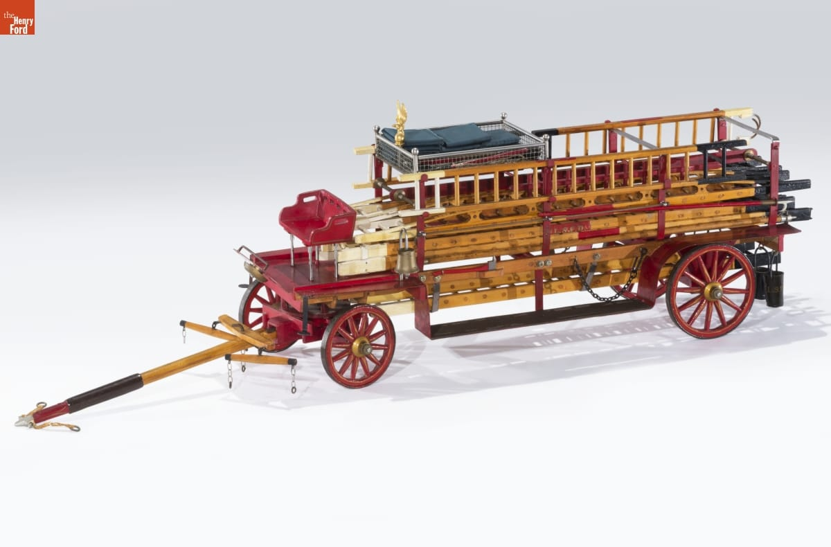 Wooden fire truck with red wheels
