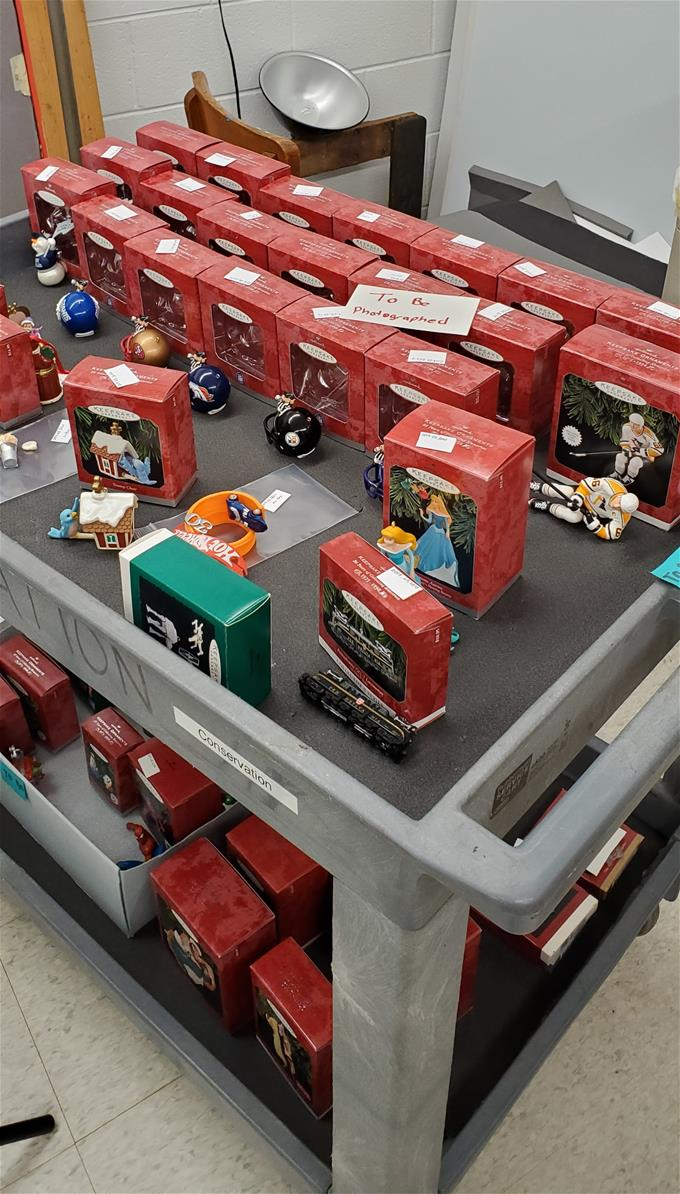 Red boxes and loose ornaments on two-level cart