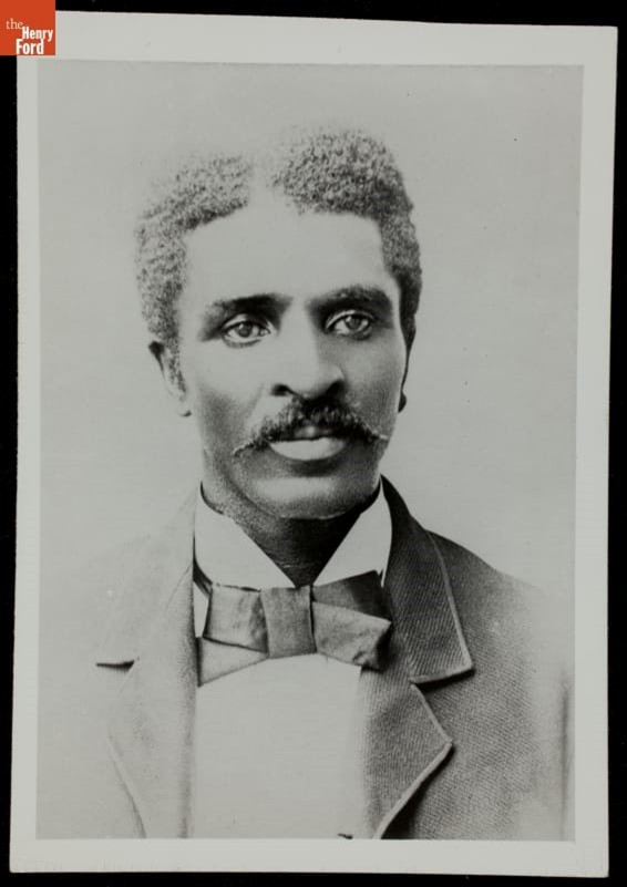 Portrait of Black man with mustache wearing jacket and tie