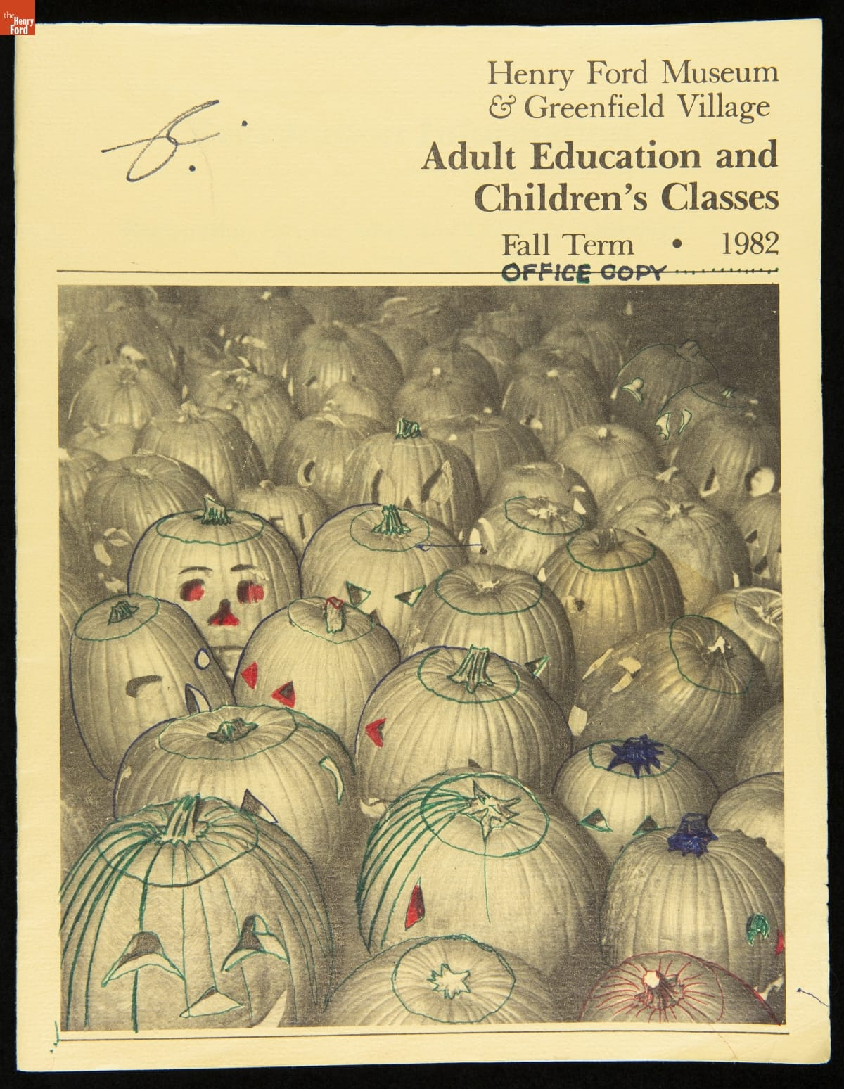 Black and white catalog cover with jack-o-lanterns, some of which have been doodled on
