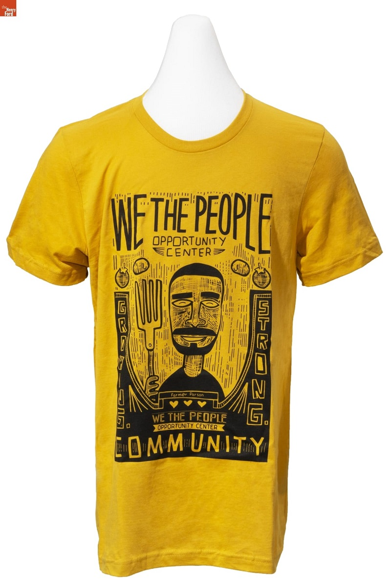 Yellow t-shirt with black caricature drawing of a man with large fork along with text and images