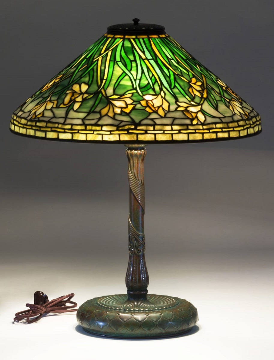 Bronze table lamp with glass shade with pattern of green and yellow daffodils