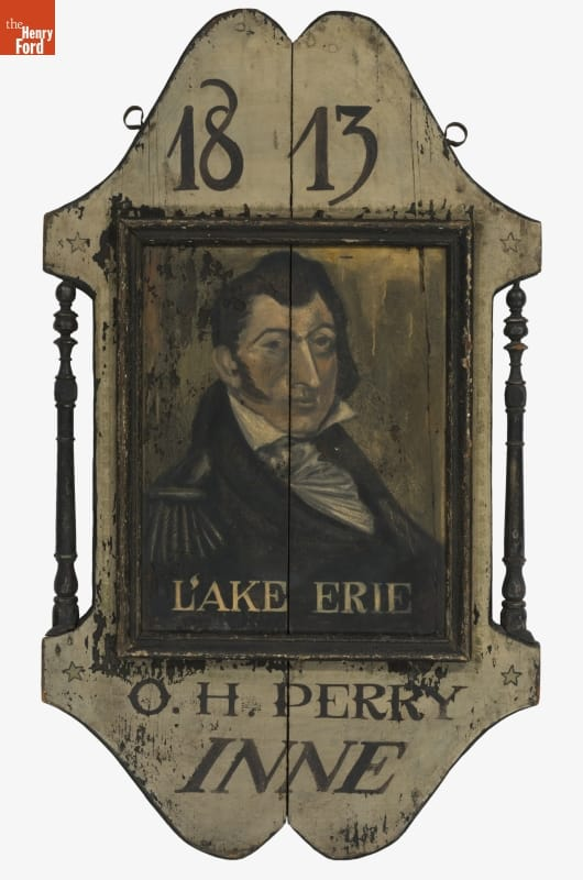Wooden sign with image of man and text