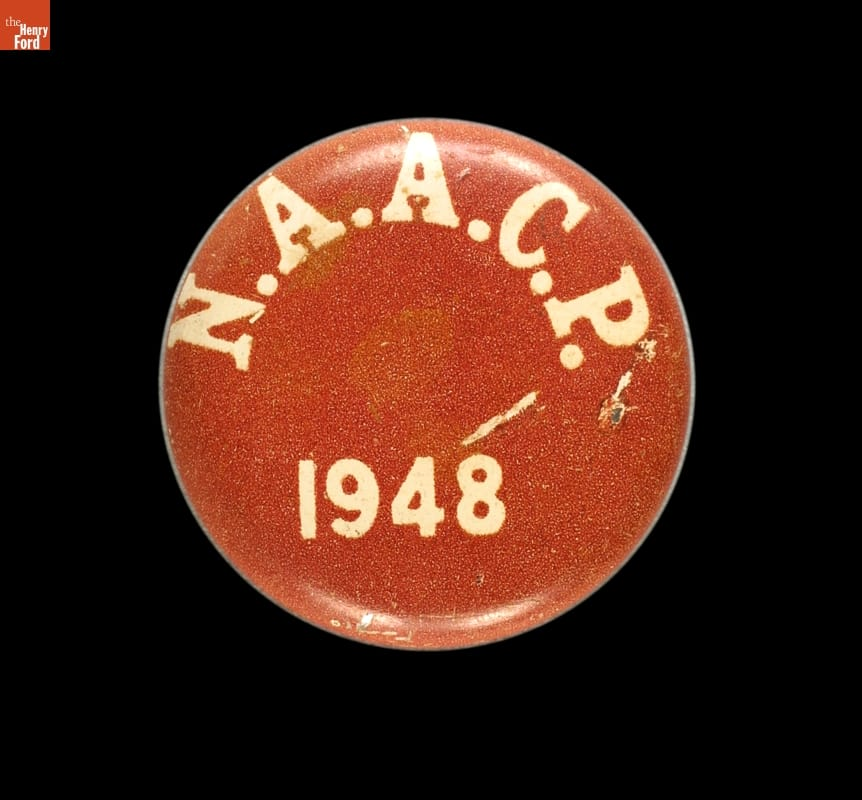 "Round red button on black background with text ""N.A.A.C.P 1948"""