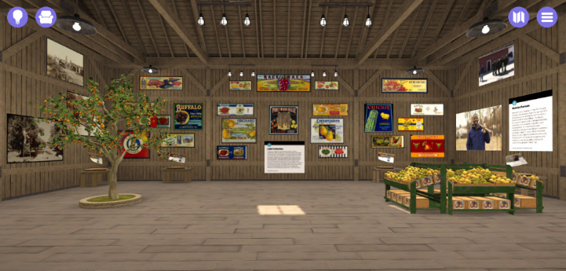 Barn-like space with orange tree growing on left side, crates of fruit on right side, various images on walls
