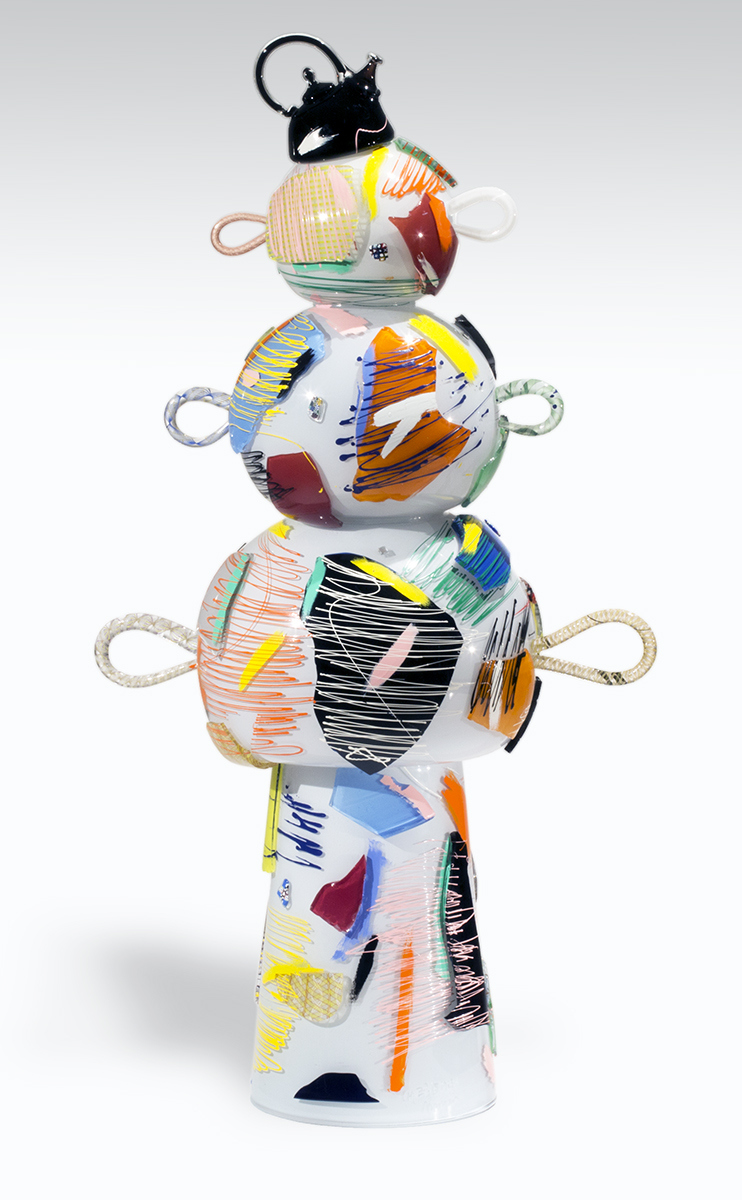 Multicolored artwork with a base topped by three progressively narrower spheres/ovals with a protruding loop on each side, with a teapot-shaped crown on top