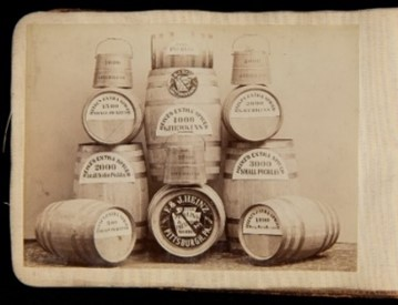 Arrangement of barrels with text on them