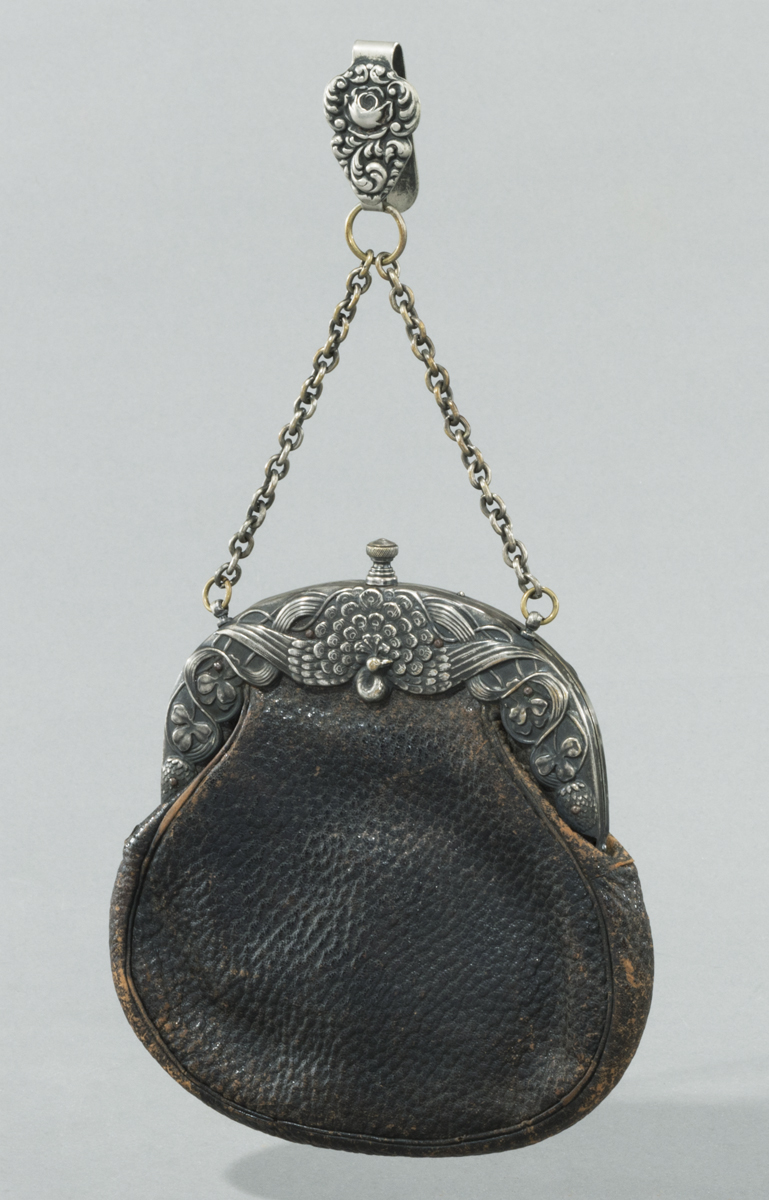 Brown pebbled leather handbag with elaborate silver clasp with a peacock in the center and a silver chain