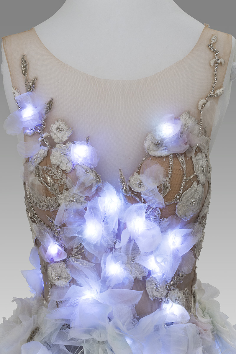 Dress bodice on dress form with integrated glowing white-blue lights