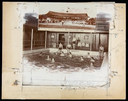 Photographs of people in swimming pool and a baseball game mounted on a large manila sheet with pencil markings