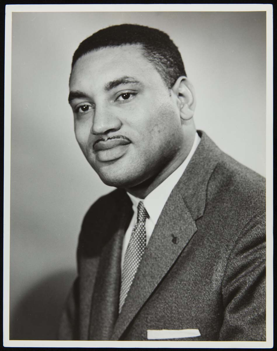 Torso and head of an African American man wearing a suit