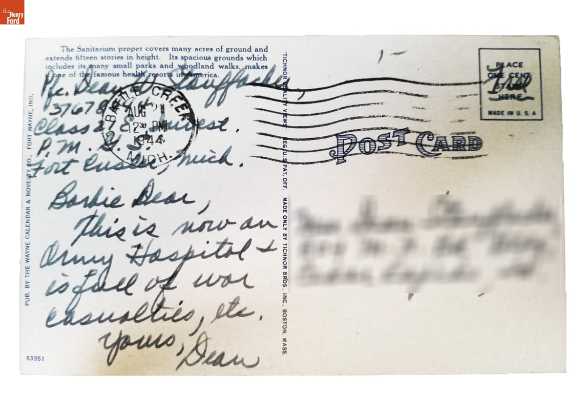 Postcard with printed text and handwritten note; blurred addressee