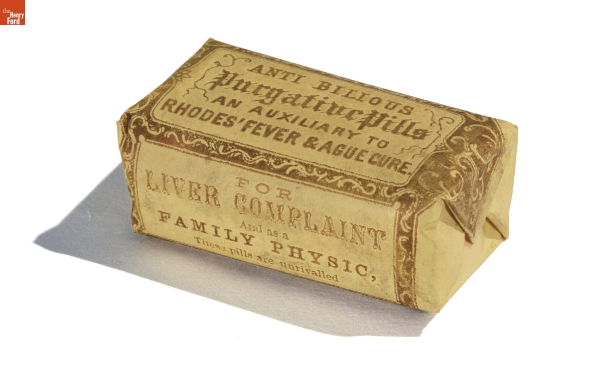 Rectangular yellow paper package (similar to a wrapped bar of soap) containing decorative edging and text