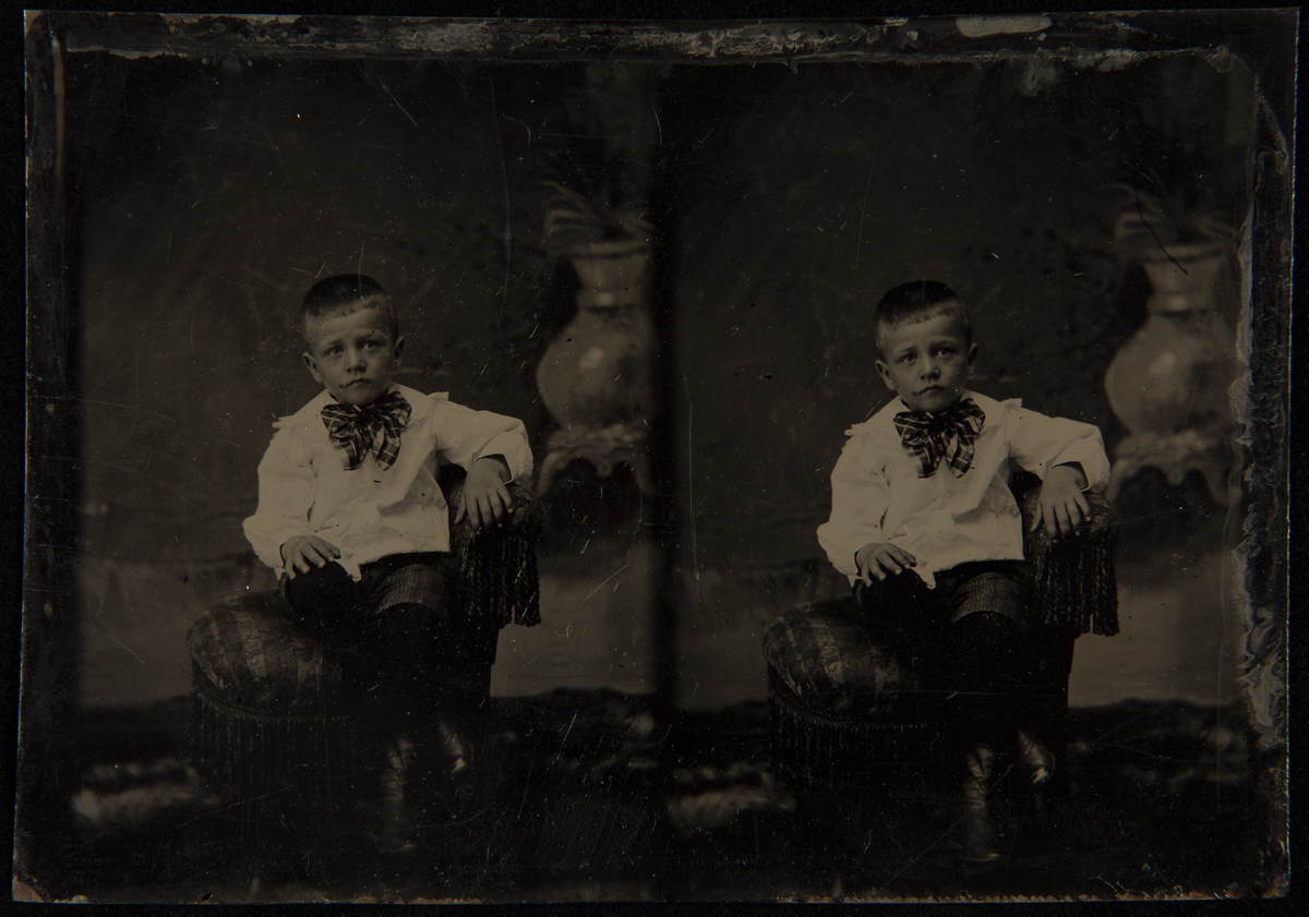 Two images of seated boy wearing white shirt and plaid bow at neck