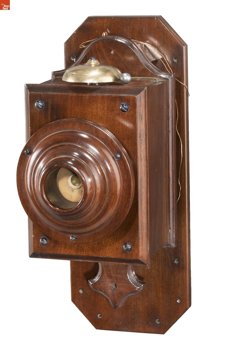 Wooden telephone designed for wall mounting; bell on top
