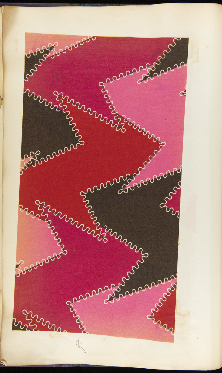 Page containing vivid red, pink, and black fabric swatch in a zigzag pattern