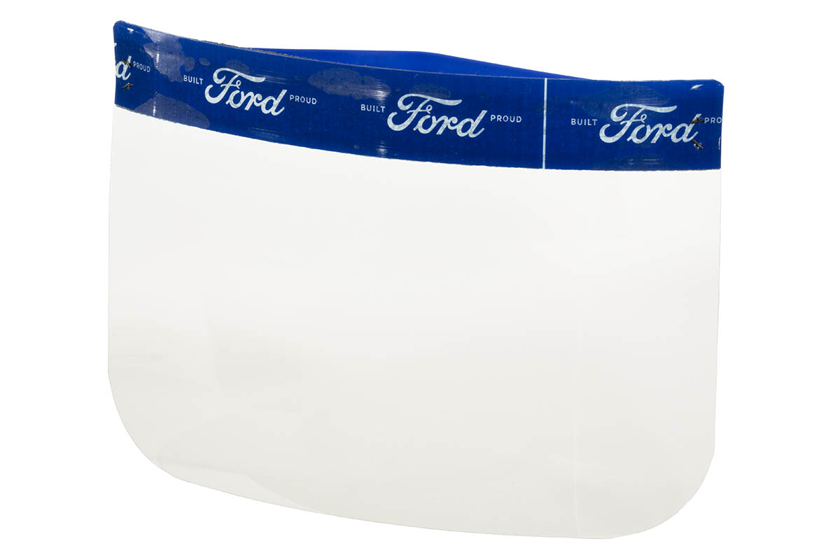 "Clear plastic rectangle with rounded corners, topped with blue band patterned with white text ""Built Ford Proud"""