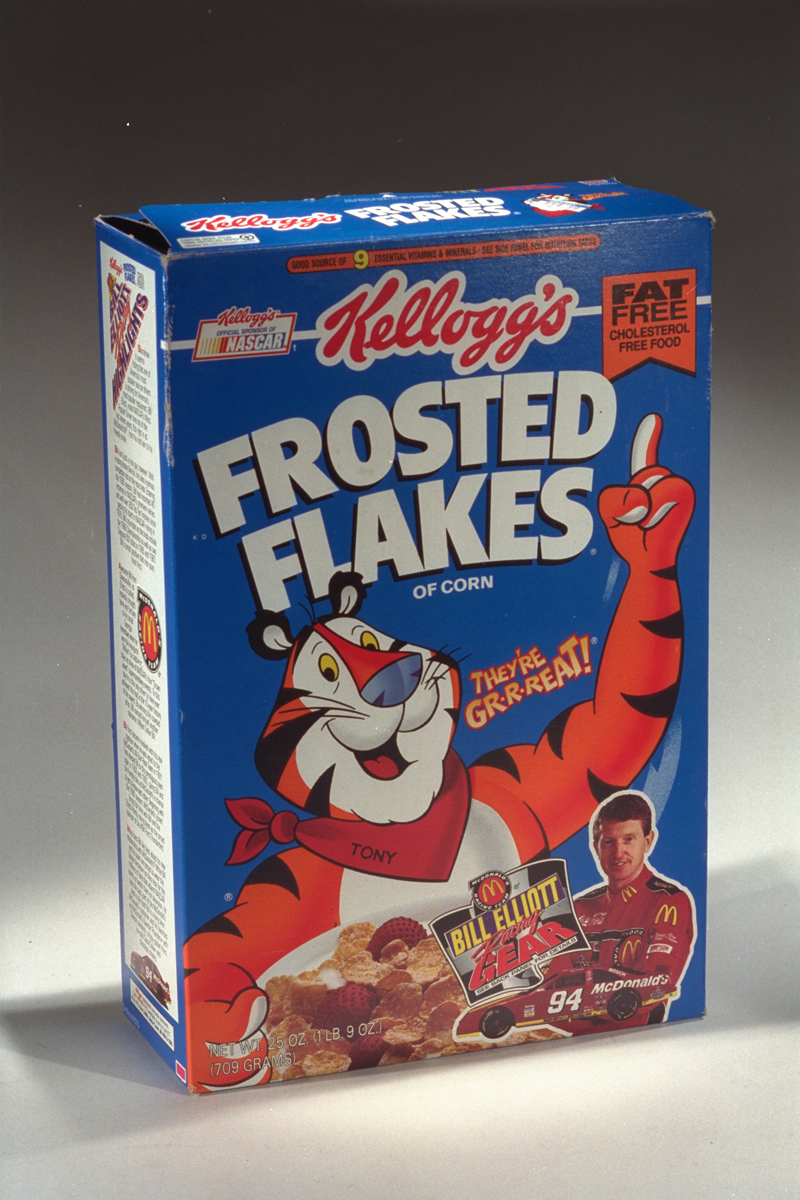 "Blue Kellogg's Frosted Flakes Breakfast Cereal box, 1994-1996, with orange-and-white ""Tony the Tiger"" and picture of racer Bill Elliott"