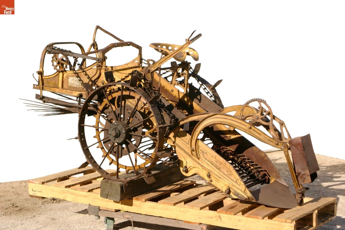 Machinery with wheels, gears, and what appears to be a conveyor belt