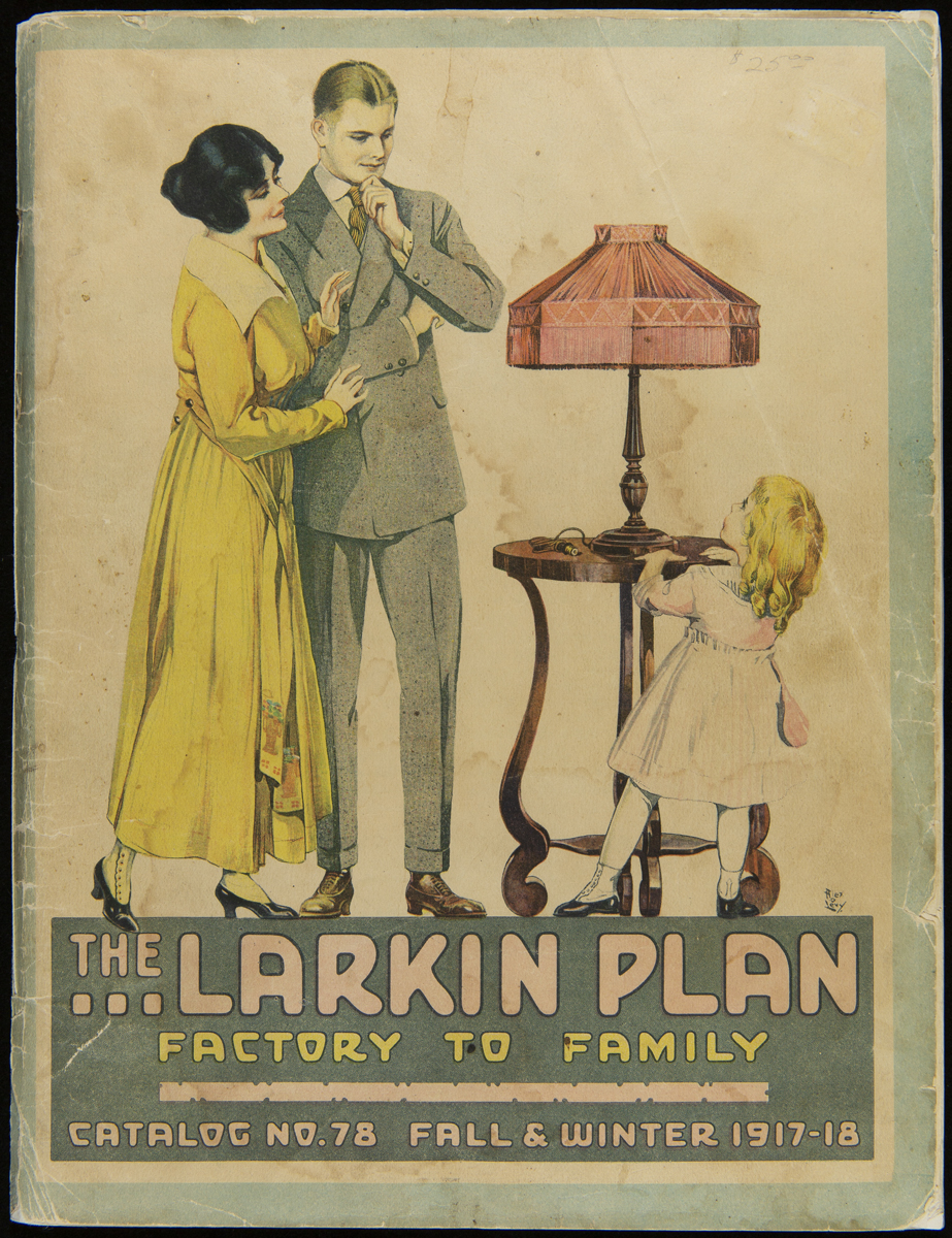 Man, woman, and little girl with table and lamp; also contains text