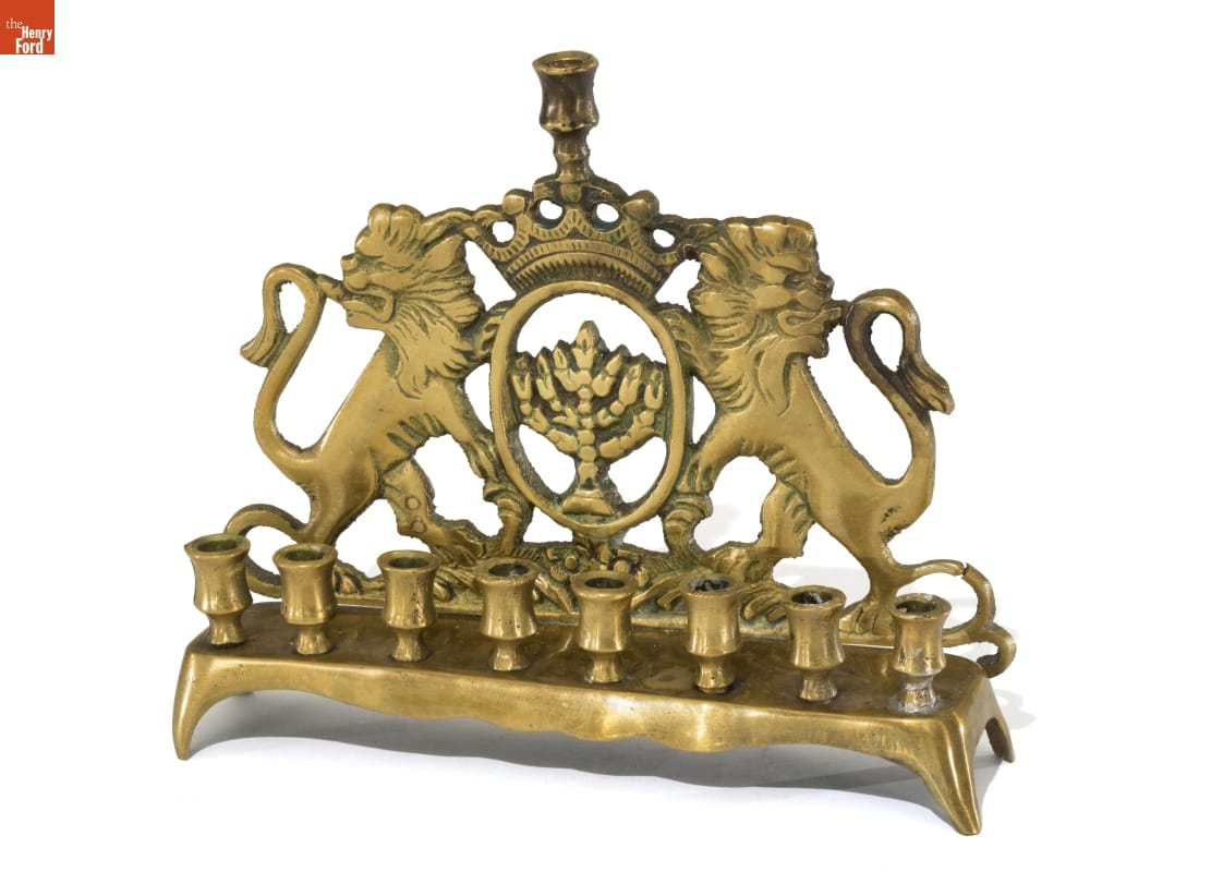 Brass candlestand with 9 spots for candles and backing with lions and a crown