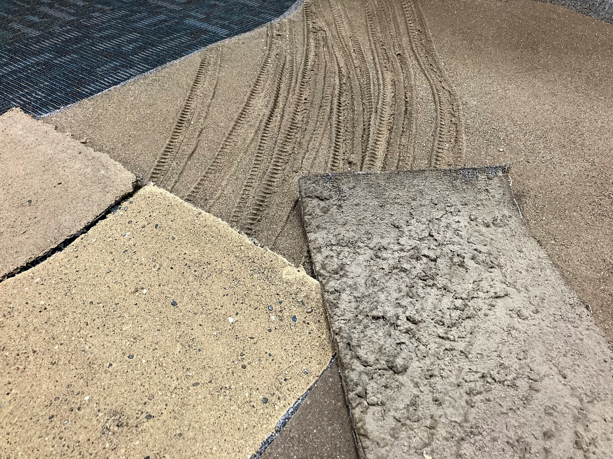 Tiles that look almost like carpet samples, but visually appear similar to dirt