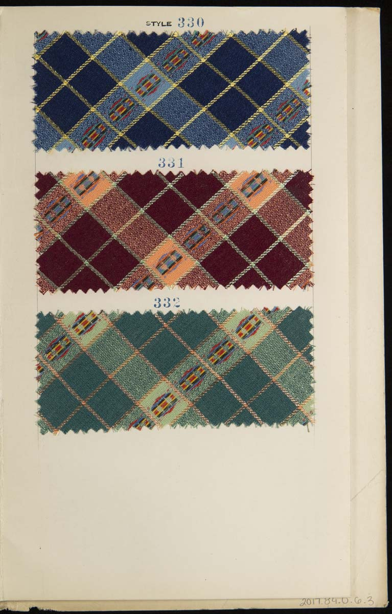 Page containing three plaid fabric swatches in blue, brown, and green
