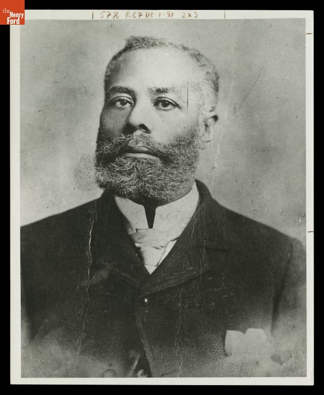 Portrait of man with beard and mustache wearing suit