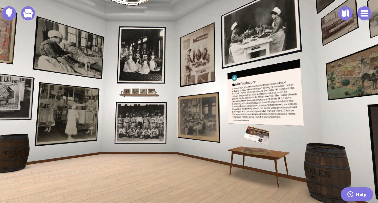 Virtual space with wood floor, white walls, and black-and-white images on the walls