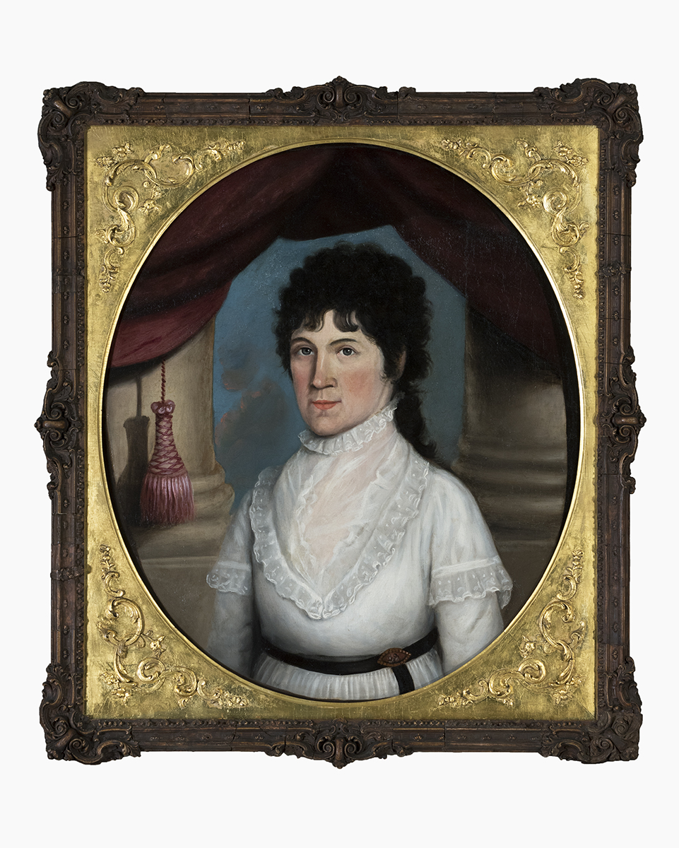 Oval painting in elaborate gold and dark frame of woman in white dress with dark curly hair standing between two large columns