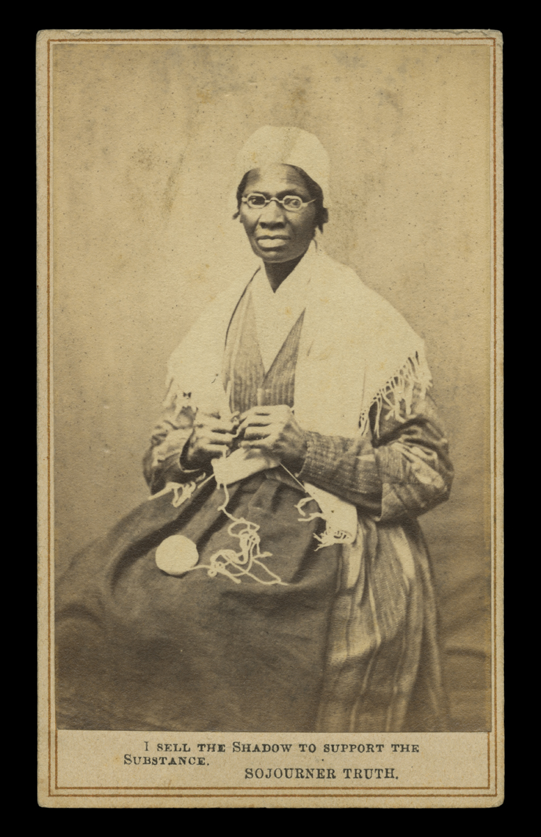 "Sepia portrait of African American woman in a dress and shawl seated in chair, knitting, with text at bottom ""I sell the shadow to support the substance – Sojourner Truth"""