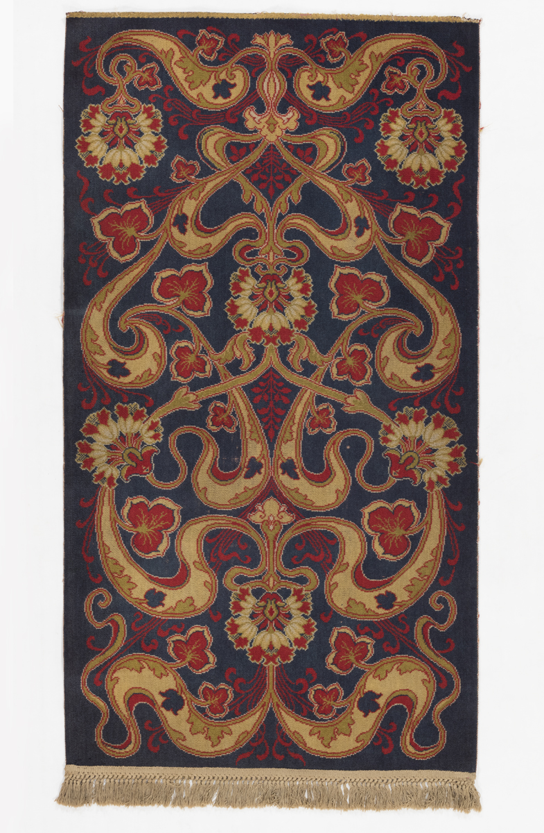 Black, red, and beige floral-patterned rug