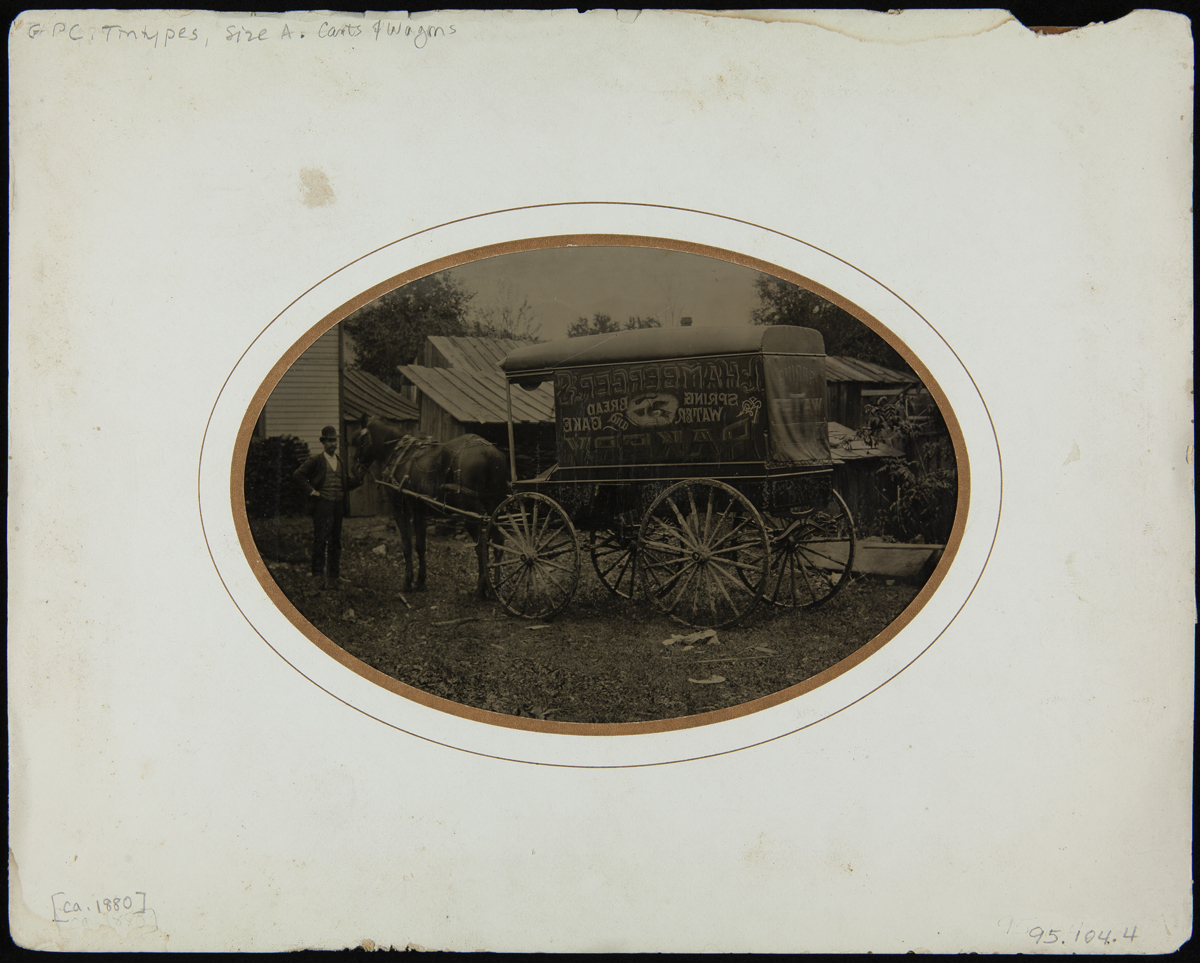 White mat with oval image of man with horse and wagon