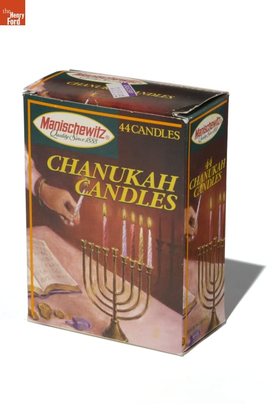 Box with image of hand lighting candles on a menorah, plus text