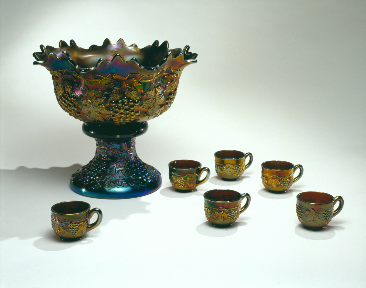 Elaborate blue and gold iridescent punchbowl and 6 cups