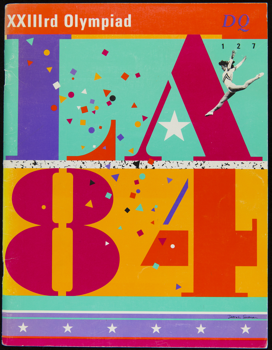 "Colorful page with large graphic characters ""L A 8 4"""