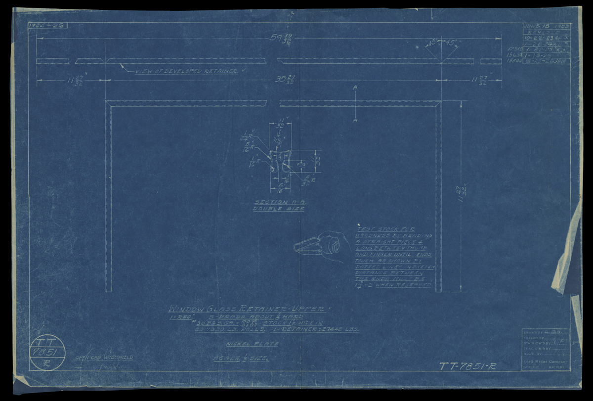 Blueprint with blue background containing line drawings with notations and text