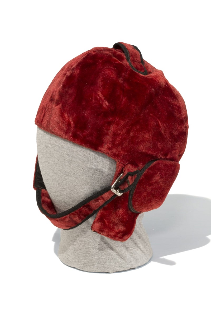 Red velvet helmet with chin strap and buckle