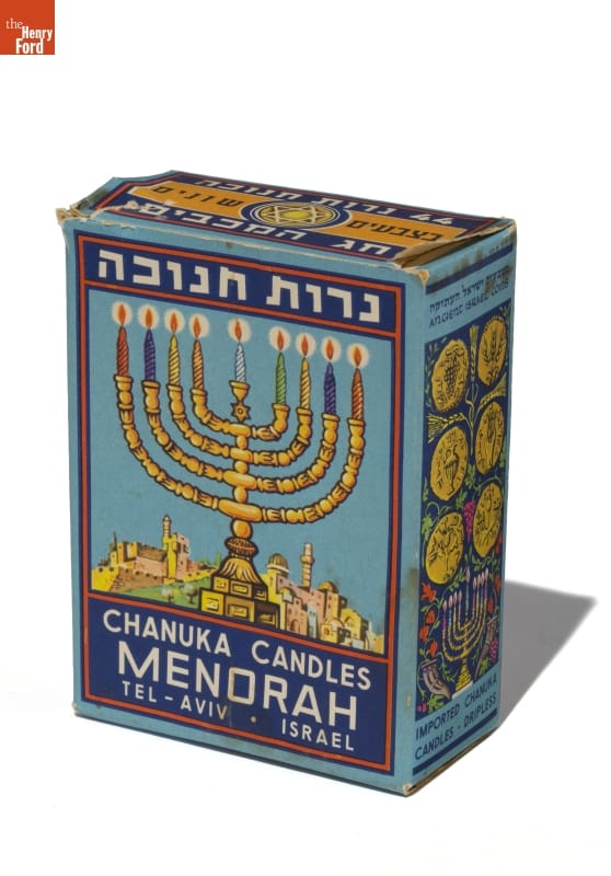 "Blue box with image of menorah and text that reads in part ""Chanuka Candles Menorah"""