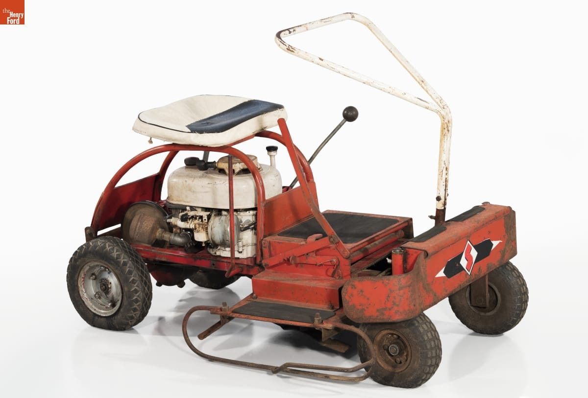 Simple red riding lawnmower with white seat and triangular handle