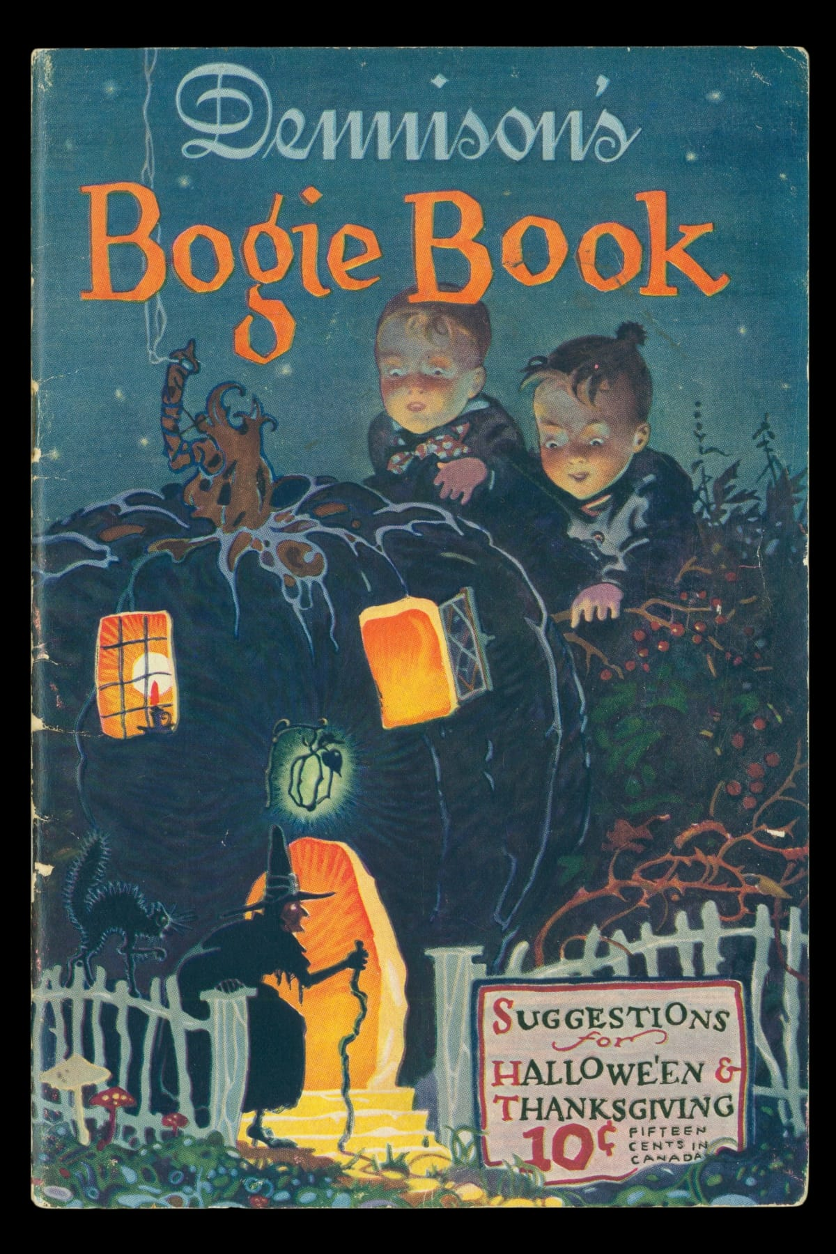 Two children look at a black pumpkin house with Halloween symbols nearby and text
