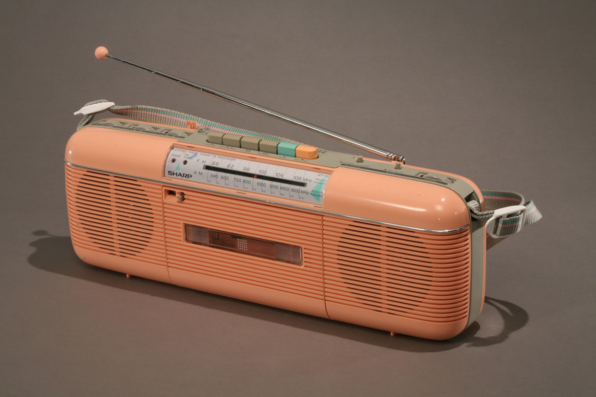 Long peach-colored cassette player and radio with antenna