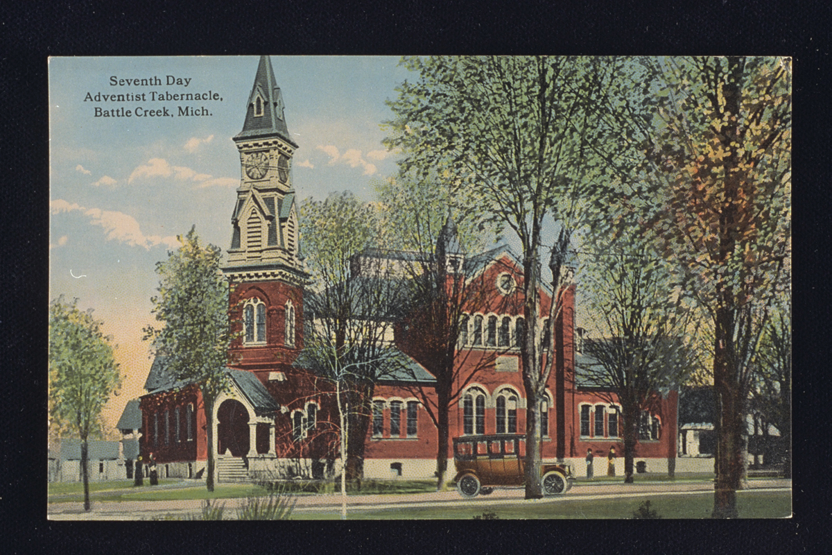 Postcard showing Seventh-day Adventist Tabernacle, 1914, a red brick building with a steeple and many arched windows.