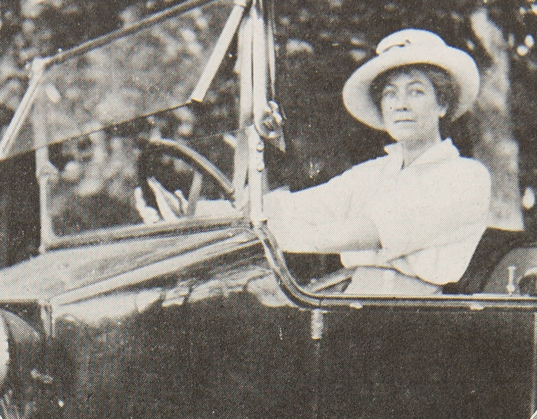 Woman behind the wheel of an open car
