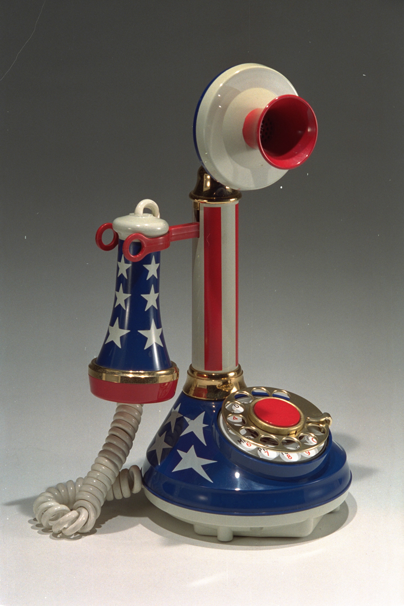 Upright telephone decorated with stripes and stars, in red, white, and blue